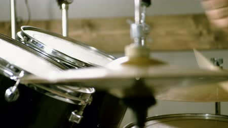 Close-up of drummer playing the drums by hitting it with sticks. 4K
