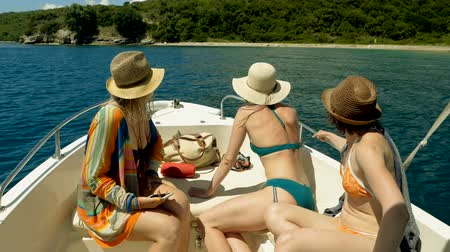 jachting : Three women sailing on a yacht on the Mediterranean sea in Greece. Slow motion. HD
