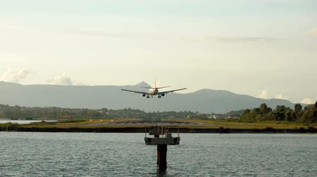 kerkyra : Passenger airplane flying n the sky. Aircraft landing on the runway at the airport of Corfu. Greece. Slow motion. HD