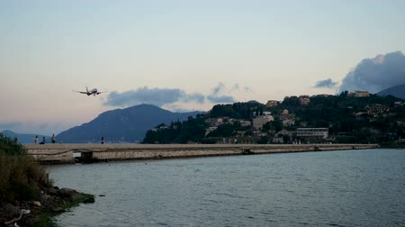 kerkyra : Passenger airplane flying in sky. Aircraft landing on the runway at airport of Corfu. Greece. Slow motion. HD
