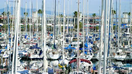 moor : Marina yacht club. Sailboats moored at the pier in Barcelona. Spain. 4K Stock Footage