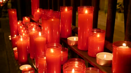 ortodoxia : Red burning wax candles on the church altar of catholic cathedral. Barcelona. Spain. 4K