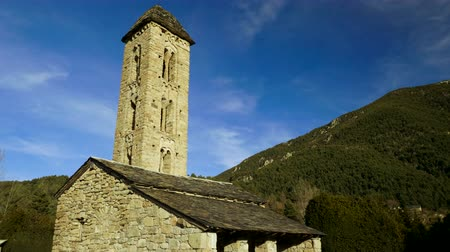 bibliai : Architecture of Andorra. The exterior of an old catholic masonry chapel. 4K Stock mozgókép