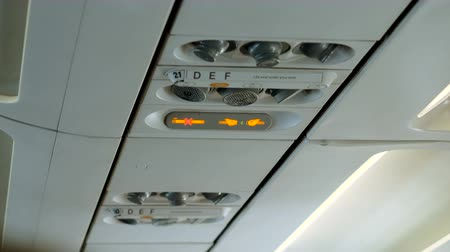 The interior of the aircraft. Sign do Not smoke and Fasten your seat belts in the plane. 4K