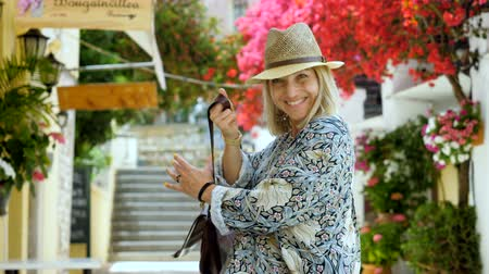 цветущий : Beautiful blonde happy cheerful woman looking at the camera and smiling. Corfu. 4K