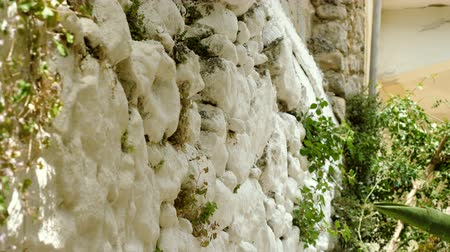 taş işçiliği : Close-up shot of the white stone wall in Greece. 4K