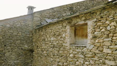 jalousie : Architecture of Andorra. The exterior of an old stone house. 4K Stock Footage