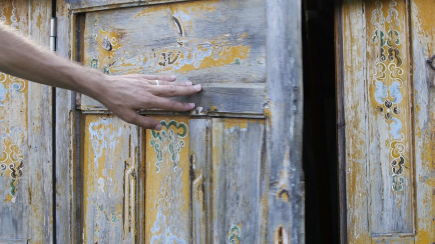 threadbare : Man Close an Old Wooden Door