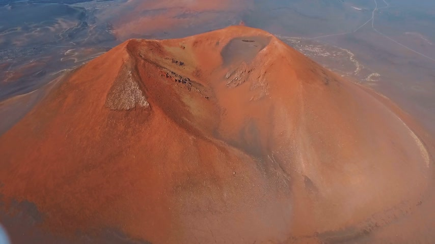 hot news : Aerial View. Flying over the volcano red. Kamchatka.