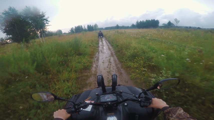 atv : Driving POV on an ATV on a rural wilderness road through a forest Stock Footage