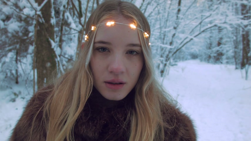 snowfield : Woman with illuminated headband in a snowfield Stock Footage