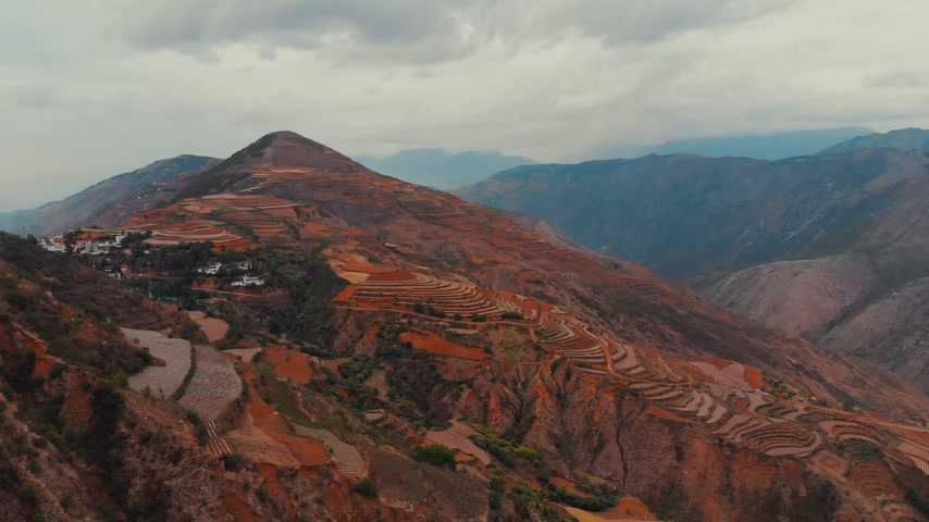 rural area : Flying over the Dongchuan Red Land in Kunming, China Stock Footage