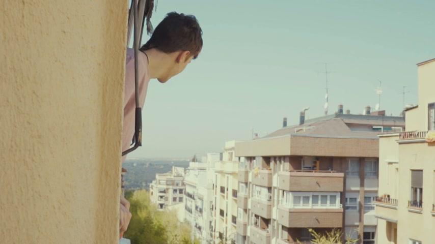 перила : Young man out on house balcony