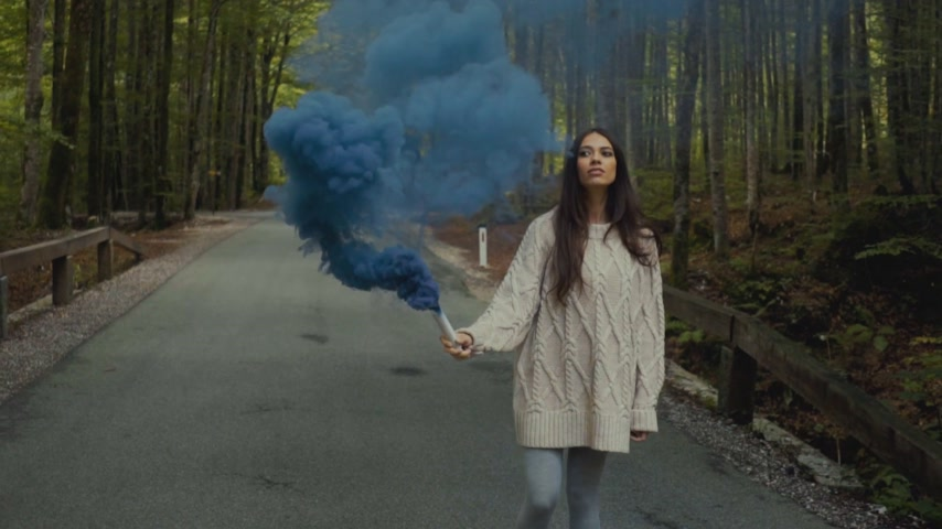 granada : Young woman with blue smoke grenade