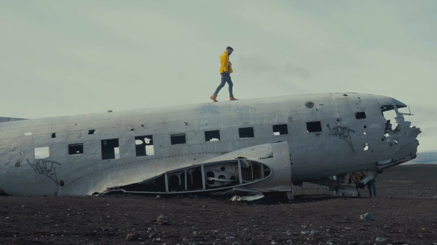 crashed : Man walking on an abandoned plane