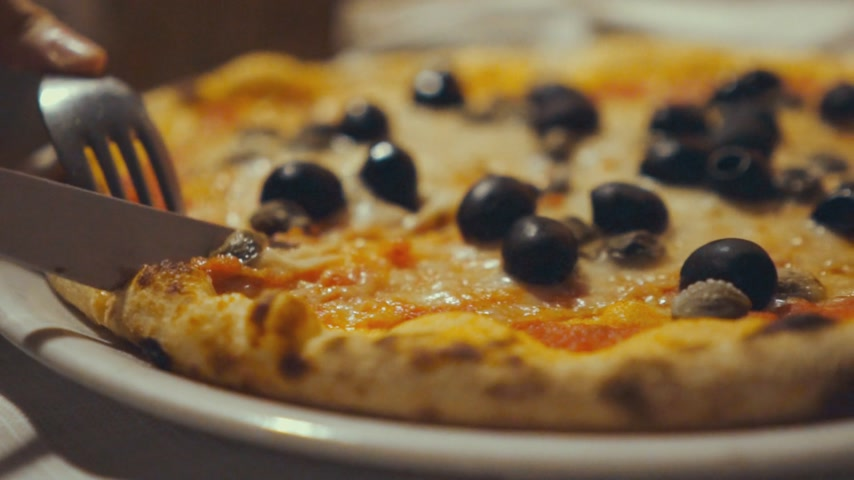 cheese slices : Slicing an olive pizza Stock Footage