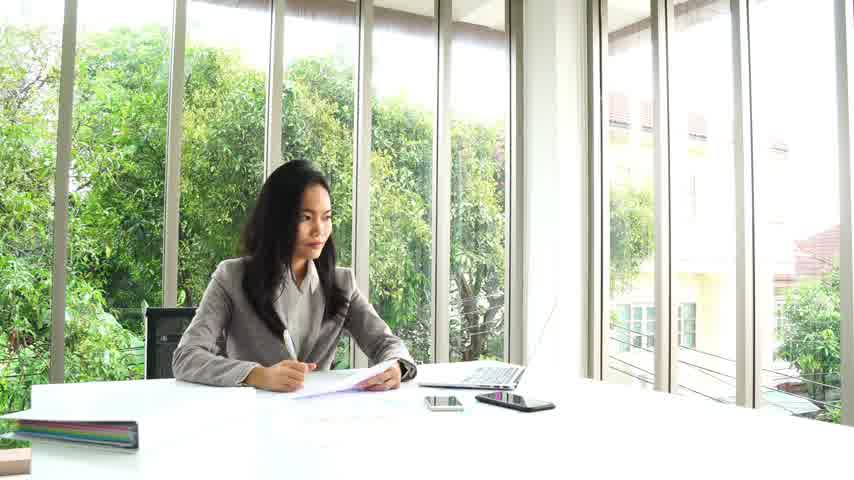 Smart asian business female working with laptop computer and review document and  at office building Wideo