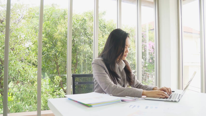 Smart asian business female working with review document at office building Wideo