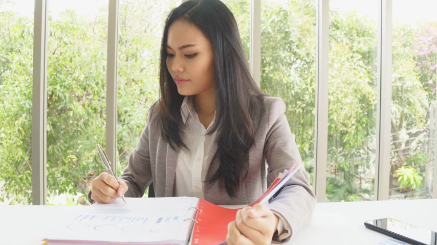 Asian business female manager sent to document to office worker Wideo