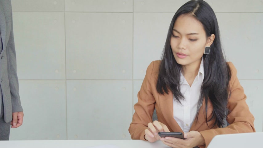 Asian business female hold bitcoin token and check online work