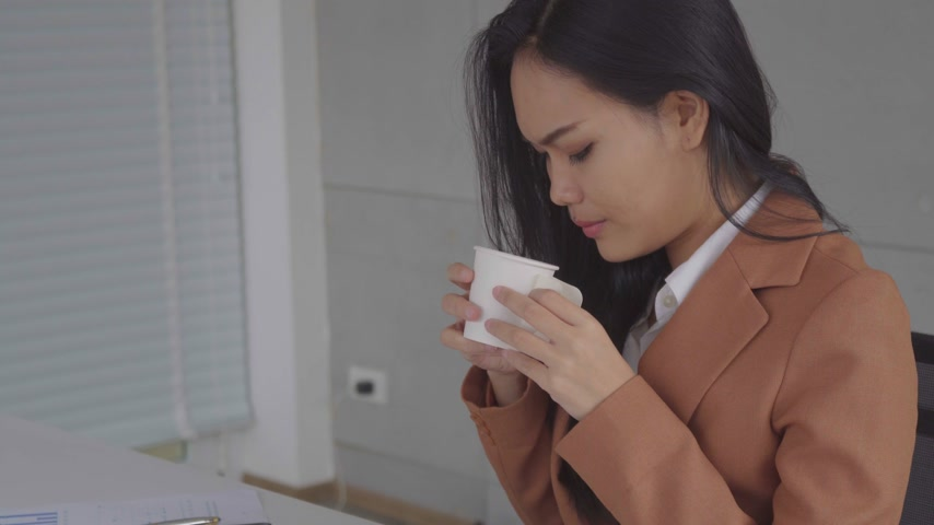 business woman drink hot coffee in relax time after the job