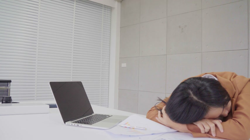 business woman work hard and sleeping in office workplace, wake up to work in the job