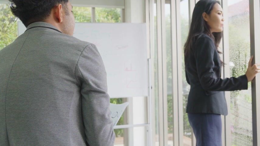 Asian business female manager get with a document to office worker