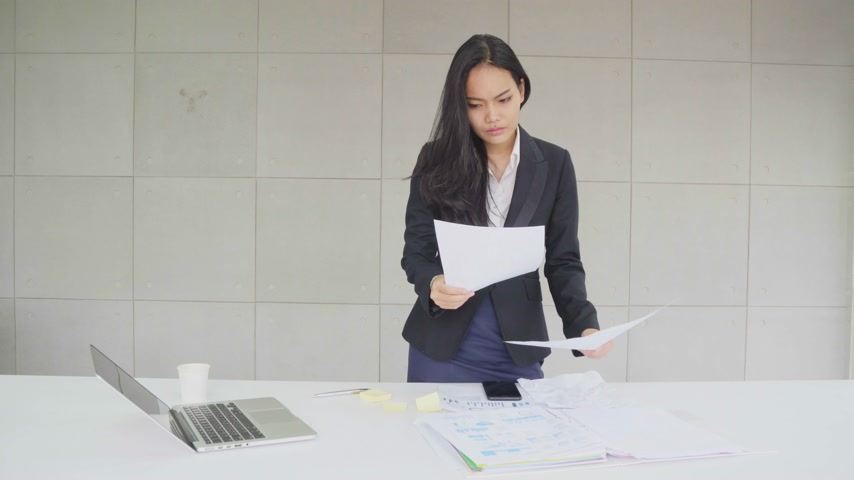 Asian business woman work serious and destroy document