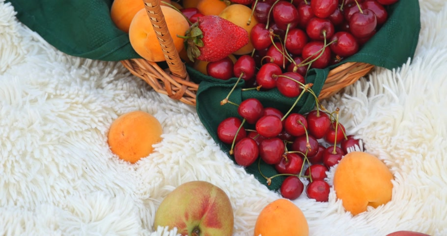 nektarinka : Basket of fresh organic fruits on white carpet