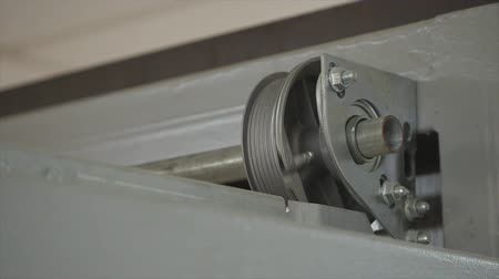 post and beam construction : Close up on mechanical garage door opener mechanism