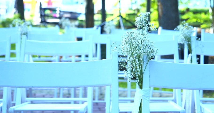 aisles : Rows of chairs for the guests at a wedding ceremony
