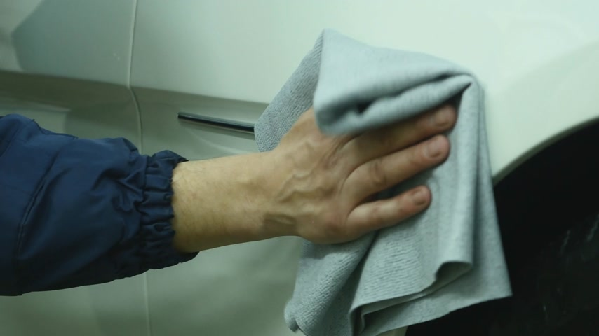 chamois : A man cleaning car with microfiber cloth - auto detailing service concept