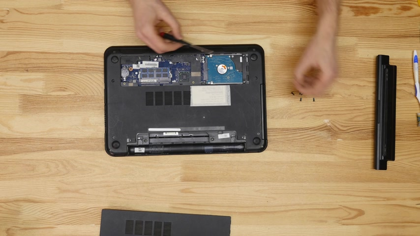 inventing : Male engineer repairs laptop