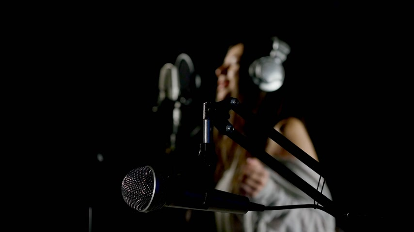 supermodel : Beautiful girl sings in a recording studio Stock Footage