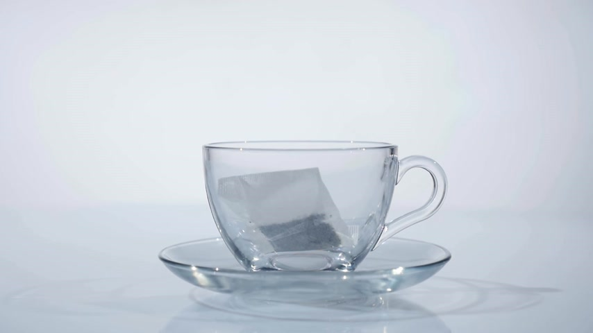 teabag : Breakfast, brewed tea. Tea bag in the Cup with hot water Stock Footage