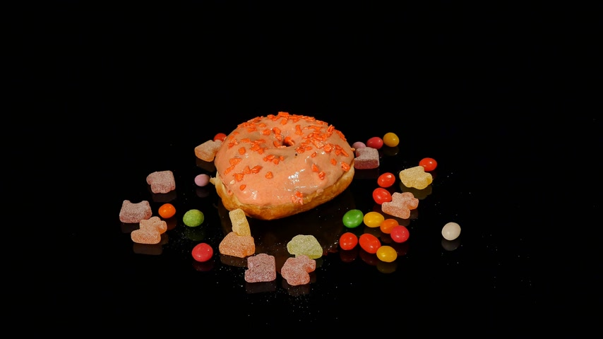 dragee : donuts with colorful glaze on a black background