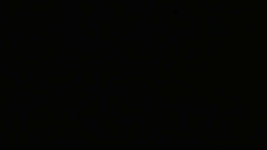 doughnut : A donut with a sugar powder falls on a black desk