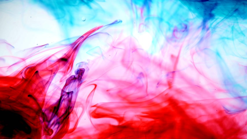 akvarell : Red and blue ink in water.Creative slow motion. On a white background. Abstract background. Stock mozgókép