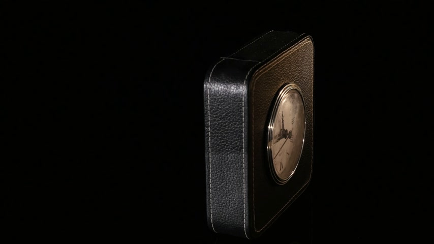 slept : Black clock - close up on black background Stock Footage