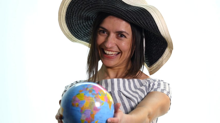 latino americana : Female explorer with the globe in her hands - isolated