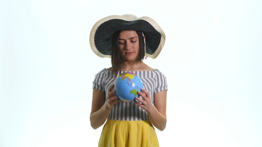 latino americana : Young woman holding a globe in his hands