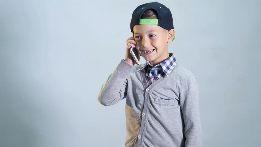 telecoms : The boy is talking on the phone and laughing Stock Footage