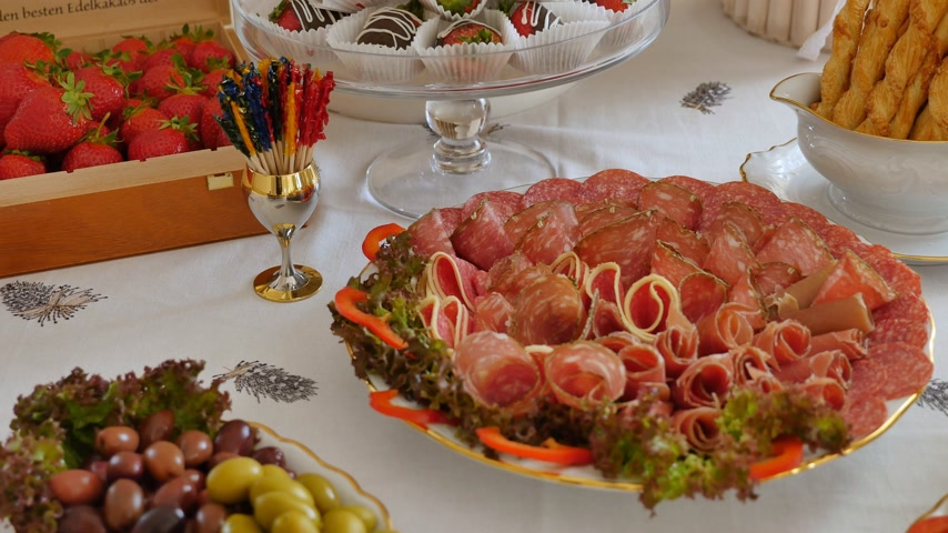repast : A long table with a lot of plates with food on holiday banquet Stock Footage