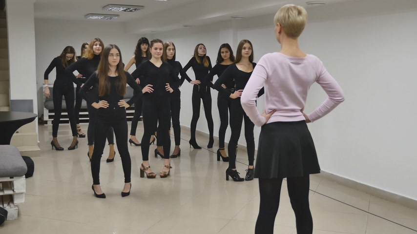 13.12.2017 Chernivtsi, Ukraine - Group of young girls trains defile in classroom in model school