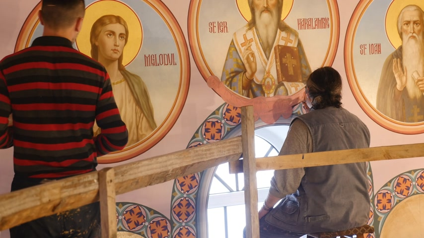 30.01.2018, Chernivtsi, Ukraine - Male Artist is Standing and Restoring the Icon of Orthodox Saint , Holding a Palette With Paints, Repairing and Restoring the Old Icons, Religious Images, Make a Precision Wideo
