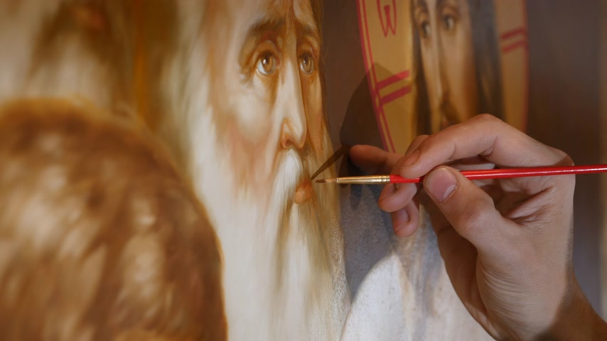 kiev : 30.01.2018, Chernivtsi, Ukraine - Man`s Artist hand is Standing and painting the Icon of Orthodox Saint , Holding a Palette With Paints