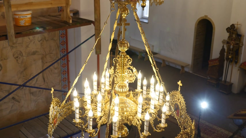 lavish : 30.01.2018, Chernivtsi, Ukraine - Chandelier in the Church. Candles Are Lit on the Chandelier in the Orthodox Church. in the Background, a Large Iconostasis Stock Footage