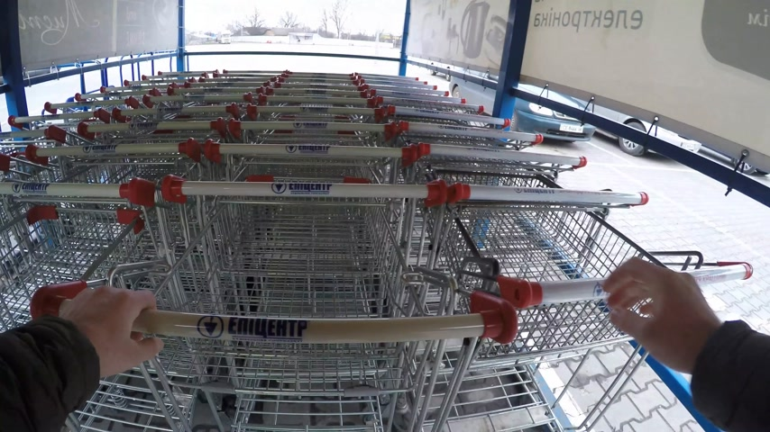 ilan : 2018.03.28 - Chernivtsi, Ukaine.people taking shopping basket and entering to supermarket