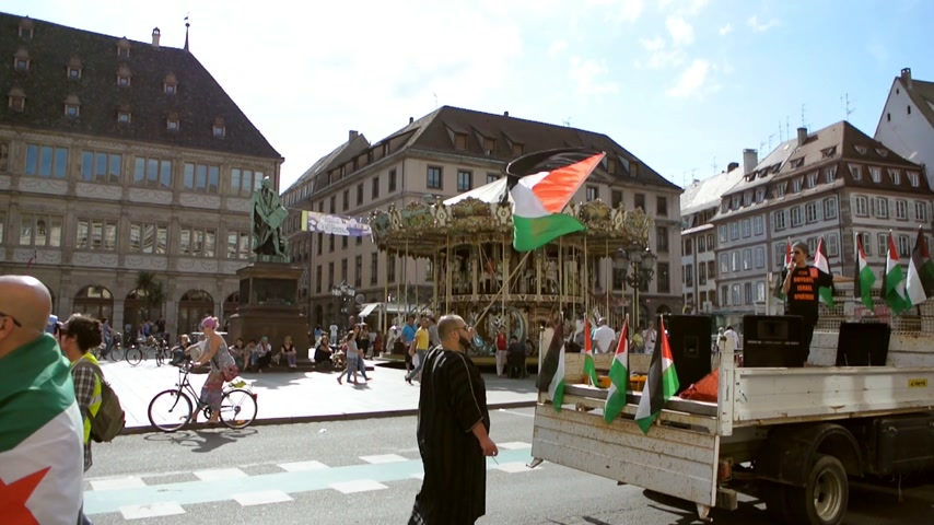 anti war : STRASBOURG, FRANCE - 9 JULY, 2014: Anti Israel protest as seen in Place Gutenberg, in Strasbourg, France with people yelling against Israeli attacks in Gaza