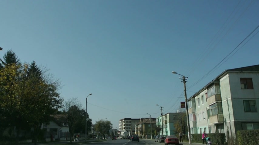 Клаус : BUCHAREST, ROMANIA - NOVEMBER 01, 2014: Car passing under electoral campaign banner of Victor Ponta - Candidacy for President of Romania